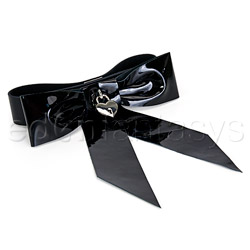 Patent leather bow wrist restraint